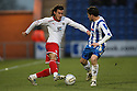 Lawrie Wilson of Stevenage takes on Ian Henderson of Colchester. - Colchester United v Stevenage - Weston Homes Community Stadium, Colchester - 26th December 2011  .© Kevin Coleman 2011