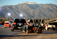 Nov 12, 2010; Pomona, CA, USA; The car of NHRA funny car driver Cruz Pedregon is towed back to the pits during qualifying for the Auto Club Finals at Auto Club Raceway at Pomona. Mandatory Credit: Mark J. Rebilas-