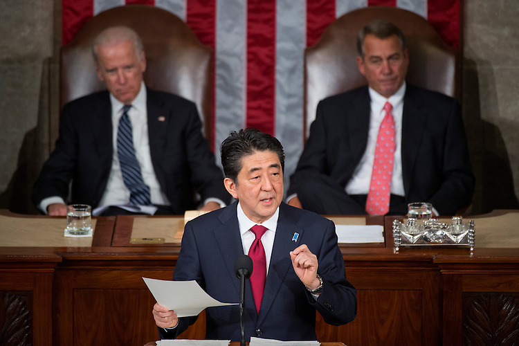 UNITED STATES - APRIL 29: Japanese Prime Minister Shinzo Abe  addresses a joint meeting of Congress in the Capitol's House chamber as Vice President Joe Biden, left, and Speaker John Boehner, R-Ohio, look on, April 29, 2015. (Photo By Tom Williams/CQ Roll Call)