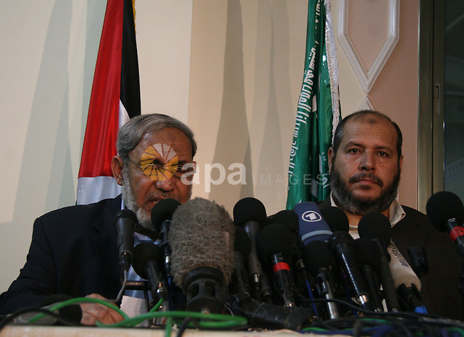 Hamas leaders Mahmud Zahar (L) and Khalil al-Hayya give a press conference in Gaza City. A Gaza Strip truce between Israel and the Islamist Hamas movement will last six months, the Palestinian group announced today. Hayya said that the truce deal envisaged further talks between them, the Palestinian leadership and the European Union to pave the way for the reopening of the Rafah crossing between Gaza and Egypt, the territory's only one that bypasses Israel.