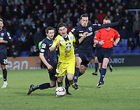 Steven Saunders (left) fouls Kenny McLean with Jackson Irvine  on the right in the Ross County v St Mirren Scottish Professional Football League match played at the Global Energy Stadium, Dingwall on 17.1.15.