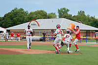 Auburn Doubledays Reid Schaller (red) and Carson Shaddy (hidden) attempt to dump the water bucket on relief pitcher Ryan Tapani (27) after closing out the game with catcher Nic Perkins (43) and first baseman Jamori Blash (26) looking on as the team starts to celebrate clinching the NY-Penn League Wild Card after defeating the Batavia Muckdogs by the score of 8-5 on September 3, 2018 at Dwyer Stadium in Batavia, New York.  (Mike Janes/Four Seam Images)