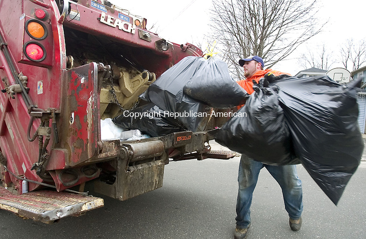 NAUGATUCK, CT. 03 April 2007-040307SV02--Josh Ruccio collects trash in Naugatuck Tuesday. Naugatuck trash haulers have picked up about 200 more tons of garbage this year than they did the previous year. That's because all of the growth in the community is causing trash collections to go up. And the public works dept. is paying a ton in overtime costs to keep up with all the trash.<br /> Steven Valenti Republican-American