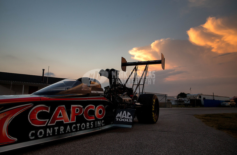 Aug. 30, 2013; Clermont, IN, USA: The car of NHRA top fuel dragster driver Steve Torrence is towed back to the pits as the sun sets during qualifying for the US Nationals at Lucas Oil Raceway. Mandatory Credit: Mark J. Rebilas-