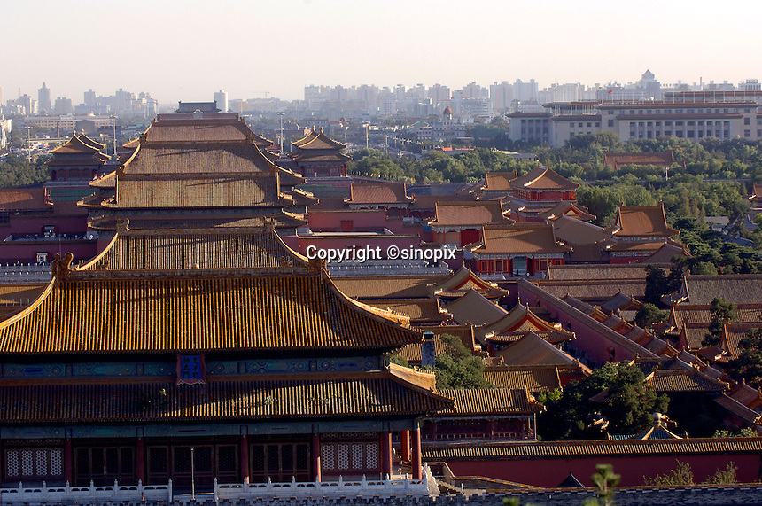 A view over the  Forbidden City in Beijing, China with the modern city in the background.  The Forbidden City is China's most popular tourist attraction..17 Sep 05