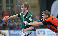 Handball 2. Bundesliga Herren - SC DHfK gegen HC Erlangen am 05.11.2013 in Leipzig (Sachsen). <br /> IM BILD: Alexander Feld (DHfK) am Ball gegen Sebastian Prei&szlig; / Preiss <br /> Foto: Christian Nitsche