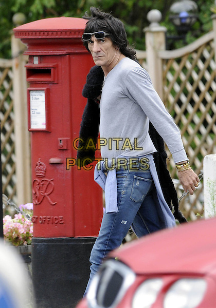 RONNIE WOOD .Spotted out and about in Old Woking, Surrey, England, 4th August 2008..half length jeans walking glasses jumper tied around waist grey top.CAP/DH.©David Hitchens/Capital Pictures