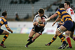 Ben Meyer goes for the gap between Murray Williams & Mark Sorenson during the Air NZ Cup rugby game between Bay of Plenty & Counties Manukau played at Blue Chip Stadium, Mt Maunganui on 16th of September, 2006. Bay of Plenty won 38 - 11.