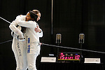 25 MAR 2016:  Princeton's Charlene Liu embraces Penn State's Jessie Gottesman-Radanovich after losing to Radanovich in the finals of the women's epee event at the Division I Women's Fencing Championship held at the Gosman Sports and Convention Center in Waltham, MA.   Damian Strohmeyer/NCAA Photos