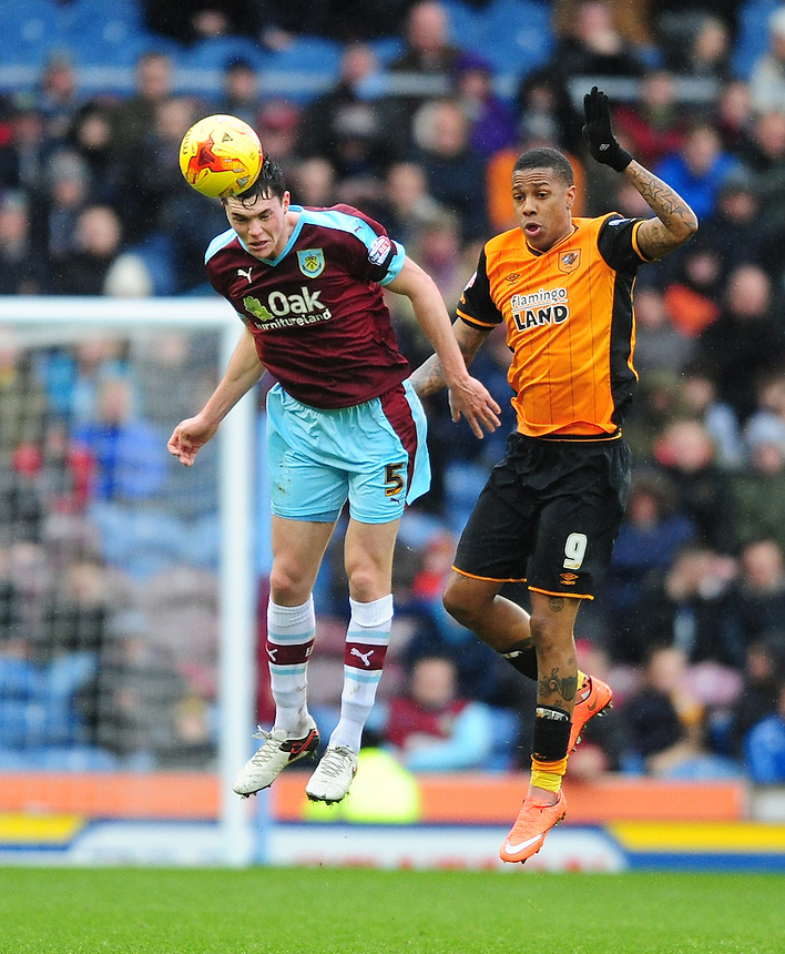 Burnley's Michael Keane heads clear under pressure from Hull City's Abel Hernandez<br /> <br /> Photographer Chris Vaughan/CameraSport<br /> <br /> Football - The Football League Sky Bet Championship - Burnley v Hull City - Saturday 6th February 2016 - Turf Moor - Burnley <br /> <br /> &copy; CameraSport - 43 Linden Ave. Countesthorpe. Leicester. England. LE8 5PG - Tel: +44 (0) 116 277 4147 - admin@camerasport.com - www.camerasport.com