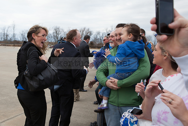 New University of Kentucky head football coach Mark Stoops and wife Chantel greeting the crowd at the R.J. Corman Hanger in Nicholasville, Ky on December 2, 2012. Photo by Adam Chaffins | Staff