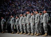 Oct. 3, 2009; Kansas City, KS, USA; U.S. Army soldiers salute during the national anthem prior to the Kansas Lottery 300 at Kansas Speedway. Mandatory Credit: Mark J. Rebilas-