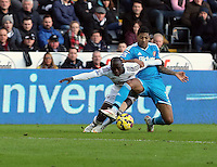 SWANSEA, WALES - FEBRUARY 07: L-R Modou Barrow of Swansea is fouled by Patrick Van Aanholt of Sunderland during the Premier League match between Swansea City and Sunderland AFC at Liberty Stadium on February 7, 2015 in Swansea, Wales.