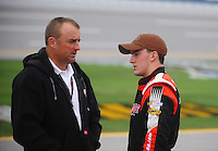 Oct. 30, 2009; Talladega, AL, USA; NASCAR Camping World Truck Series driver Austin Dillon (right) talks with father Mike Dillon during qualifying for the Mountain Dew 250 at the Talladega Superspeedway. Mandatory Credit: Mark J. Rebilas-