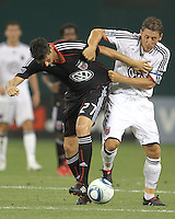 Branko Boskovic #27 of D.C. United  tangles with Michael Brown #11 of Portsmouth FC during an international friendly match at RFK Stadium on July 24 2010, in Washington D.C. United won 4-0.