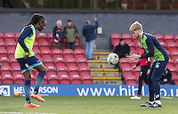 Marcus Bean of Wycombe Wanderers warms up with Reece Clifford Wycombe assistant sports scientist ahead of the Sky Bet League 2 match between Grimsby Town and Wycombe Wanderers at Blundell Park, Cleethorpes, England on 4 March 2017. Photo by Andy Rowland / PRiME Media Images.