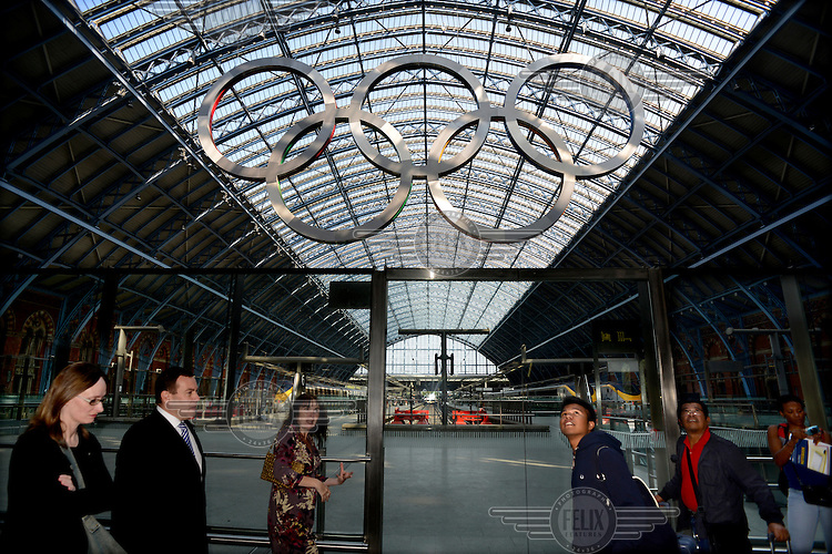 St Pancras Station, London, with the Olympic Rings mounted above the Eurostar train platform.
