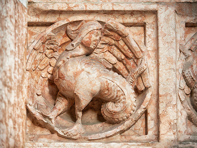 Medieval relief sculptures of mythical half man half dragon creature on the exterior of the Romanesque Baptistery of Parma, circa 1196, (Battistero di Parma), Italy