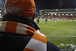 A home fan in the stands watching the players warming up at Blackpool Football Club's Bloomfield Road stadium before the club played host to Liverpool FC in a Premier League match. The home side won by two goals to one. It was the first time the clubs had met in a league match since Blackpool were last in the top division of English football in 1970-71.