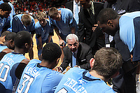 North Carolina Tar Heels head coach Roy Williams talks with his team during the game against Virginia in Charlottesville, Va. North Carolina defeated Virginia 54-51.