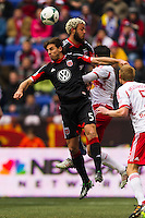 Dejan Jakovic (5) and Nick DeLeon (18) of D. C. United go up for a header. The New York Red Bulls and D. C. United played to a 0-0 tie during a Major League Soccer (MLS) match at Red Bull Arena in Harrison, NJ, on March 16, 2013.