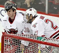 UNO goalie John Faulkner grimaces during a break in play. Faulkner appeared to be shaken up after a scrum at the net midway through the third period. Looking on is Matt Ambroz. UNO beat St. Cloud State 3-0 Friday night at Qwest Center Omaha.  (Photo by Michelle Bishop)