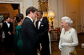 President Barack Obama and Queen Elizabeth II greet guests, including actor Colin Firth, at a dinner in honor of the Queen at Winfield House in London, England, May 25, 2011. Firth received an 2010 Academy Award for his portrayal of the Queen's father, King George VI, in The King's Speech. .Mandatory Credit: Pete Souza - White House via CNP