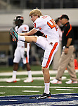 Oregon State Beavers punter Keith Kostol #48 warming up before the game between the Oregon State Beavers and the TCU Horned Frogs at the Cowboy Stadium in Arlington,Texas. TCU defeated Oregon State 30-21.