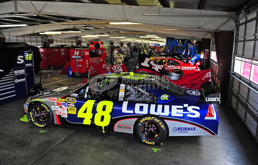 Aug. 10, 2009; Watkins Glen, NY, USA; The cars of NASCAR Sprint Cup Series driver Jimmie Johnson (48) and Tony Stewart (14) sit in the garage area prior to being opened to crew members before the Heluva Good at the Glen at Watkins Glen International. The race is being run on Monday after being postponed due to rain. Mandatory Credit: Mark J. Rebilas-