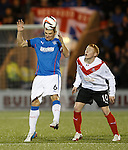 Lee McCulloch heads away from Nathan Blockley