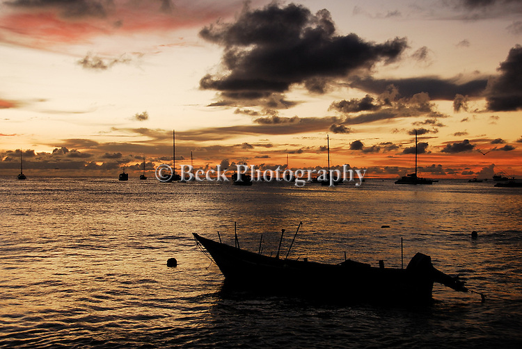 BOAT RESTING AT SUNSET