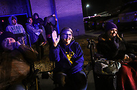 """NWA Democrat-Gazette/CHARLIE KAIJO Richard Keesee (from left), Shanna Keesee and Victoria Keesee of Springdale wave as floats ride by, Saturday, November 30, 2019 during an annual Christmas parade along Emma Ave. in Springdale.<br /> <br /> Floats, bands and Santa greeted visitors for the 23rd annual Christmas parade. This year's theme was """"Christmas Vacation"""". The parade started at Parsons Stadium and headed west on Emma Avenue, concluding at Harris Street."""
