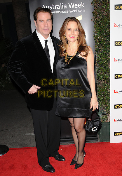 JOHN TRAVOLTA & KELLY PRESTON .at G'Day USA LA Black Tie Gala held at The Hollywood Palladium in Hollywood, California, USA, January 22nd, 2011..full length black velvet suit tie jacket silk satin dress gold necklace married couple husband wife tights shoes bag .CAP/RKE/DVS.©DVS/RockinExposures/Capital Pictures.