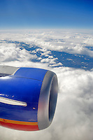 Clouds over California from 32,000 feet with jet engine from Boeing 737 jet.