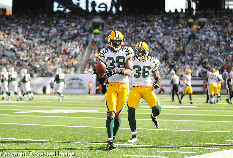 Green Bay Packers cornerback Tramon Williams jogs down the sideline near teammate Nick Collins after his interception against the New York Jets during the first half of the game at The New Meadowlands Stadium in East Rutherford, NJ on Oct. 31, 2010.