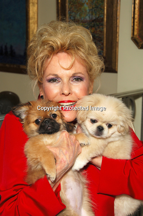 Eileen Fulton and her new dogs Ella Fitzgerald and  Rosemary Clooney ..at a Chinese New Year's Party at Eileen Fulton's apartment..in New York City on January 29, 2006. Eileen Fulton was also celebrating her 2 new dogs, Ella fitzgerald and Rosemary Clooney. ..Photo by Robin Platzer, Twin Images