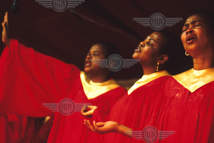 © Dieter Telemans / Panos Pictures..Gospel, Johannesburg, South Africa, 12/2000..Female choir leading the congregation in song during a Sunday service at the National Pentecostal Church.
