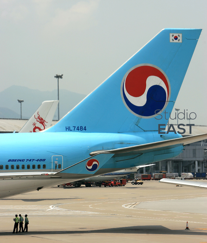A Korean Air airplane taxis in Beijing Capital Airport, in Beijing, China, on August 10, 2006. Photo by Servais Mont/Pictobank.