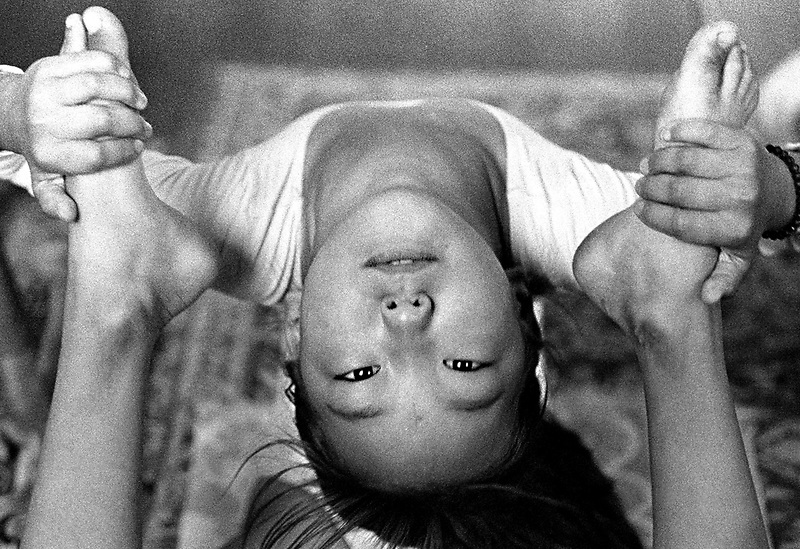A young Mongolian contortionist stretches during a class.