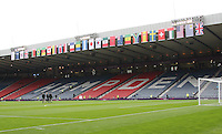 Men's Olympic Football match Honduras v Morocco on 26.7.12...General view of Hampden Park with the match officials inspecting the pitch before the Honduras v Morocco Men's Olympic Football match at Hampden Park, Glasgow...........