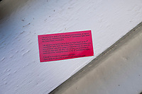 "A view of a card given out to area immigrants as part of ""Know Your Rights"" efforts by advocates of immigrants. The card has information about people's constitutional rights and what to say if immigration enforcement officers come to one's home. On one side is English, and on the other side is Haitian-Creole."