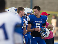 NWA Democrat-Gazette/BEN GOFF @NWABENGOFF<br /> Hunter Loyd, Rogers sophomore quarterback, talks with a teammate on the sidelines Friday, Aug. 11, 2017, during Rogers practice at Whitey Smith Stadium in Rogers.