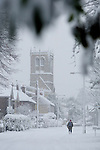 Pix: Shaun Flannery/shaunflanneryphotography.com...COPYRIGHT PICTURE>>SHAUN FLANNERY>01302-570814>>07778315553>>..1st December 2010...........Snowfall in the United Kingdom, December 2010..Walk to work, St Mary's Church, Sprotbrough.