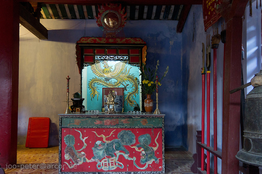 shrine in temple in  the city Hoi An, Vietnam. Vietnamese belief is a blend of Buddhism, Taoism and animism.