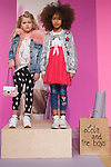 Models pose in outfits from the Lola & The Boys collection during the petitePARADE fashion show at Children's Club in the Jacob Javits Center in New York City on February 25, 2018.