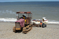 Landing a fishing boat at  Weybourne, Norfolk.