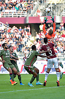 27th October 2019; Olympic Grande Torino Stadium, Turin, Piedmont, Italy; Serie A Football, Torino versus Cagliari; Robin Olsen the goalkeeper of Cagliari catches the ball above Armando Izzo of Torino FC - Editorial Use