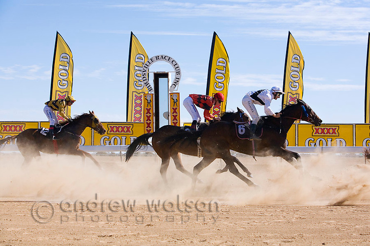 Horse racing in the outback at the annual Birdsville Cup races.  Every September the remote town hosts the biggest bush racing carnival in outback Australia.  Birdsville, Queensland, AUSTRALIA.  © Andrew Watson / Axiom