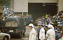 A police van carrying Aum Shinrikyo cult founder Shoko Asahara (born Chizuo Matsumoto) enters the Tokyo Metropolitan Police Department underground car park  on May 16th, 1995 in Chiyoda-ku, Tokyo, Japan. Asahara was arrested on suspicion of involvement in murder. He was found in a hideout in one of the Aum facilities in Kamikuishiki, Yamanashi after a search that involved checking 130 different locations across 20 prefectures. Approximately 200 members of the press were waiting for the van. (Photo by Mainichi Newspapers/AFLO)