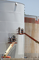 Workers paint a tank at Marathon Oil's west side loading facility Monday, June 20, 2007 in Columbus, Ohio.